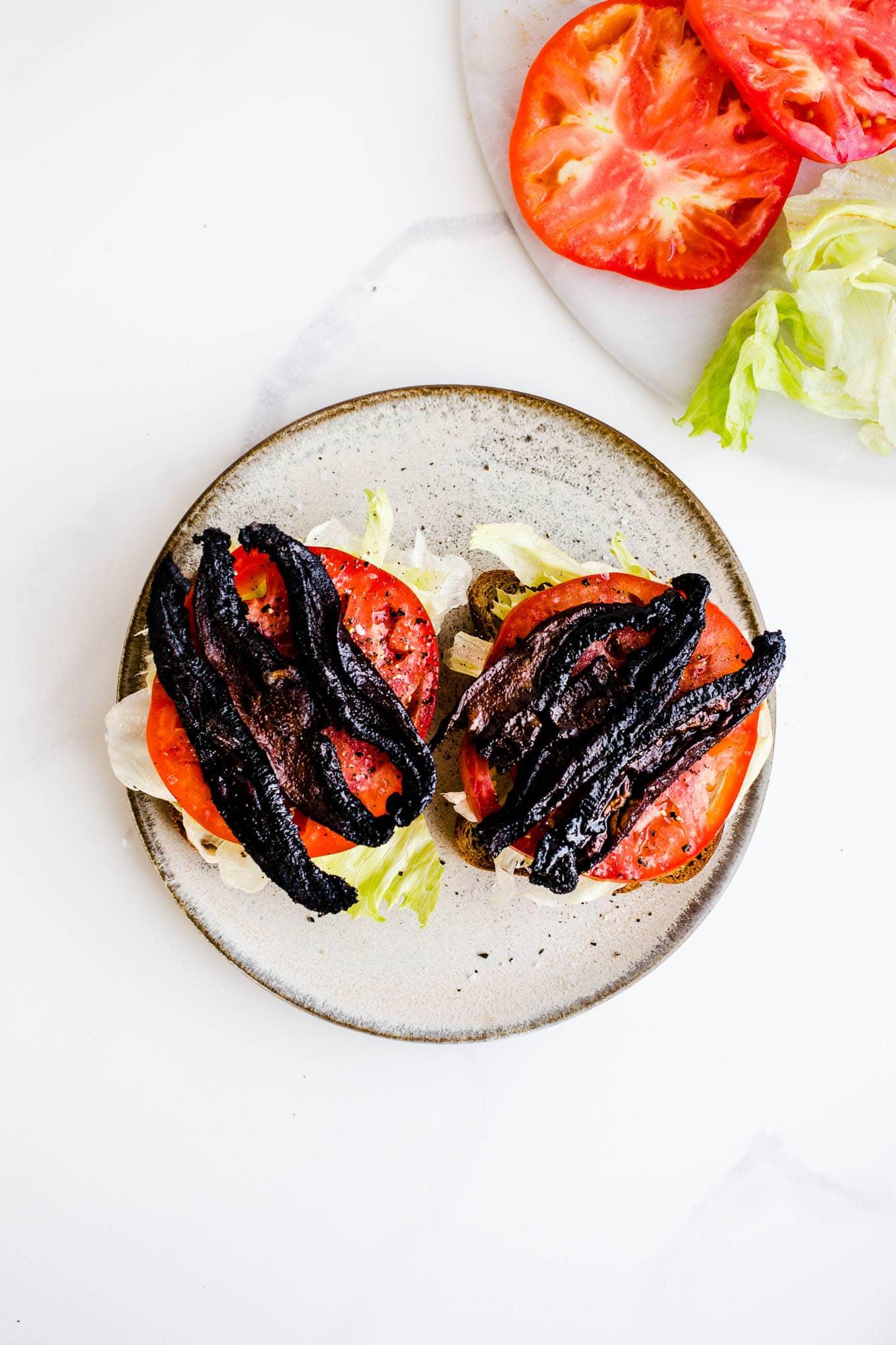 mushroom bacon on tomato and lettuce